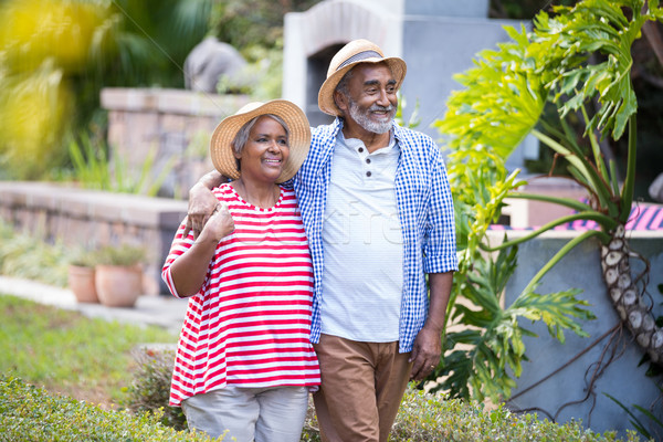 Smiling senior couple walking in yard Stock photo © wavebreak_media