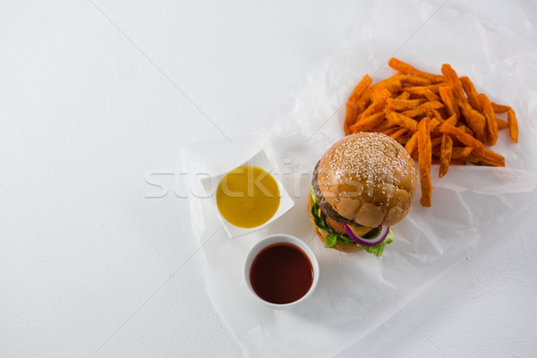 Hamburger by French fries and dips in bowl Stock photo © wavebreak_media