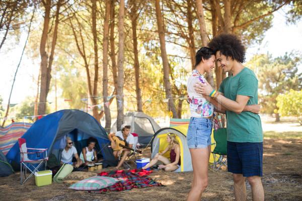 Oldalnézet pár áll szemtől szembe barátok táborhely Stock fotó © wavebreak_media
