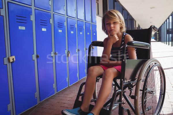 Portrait of schoolboy sitting on wheelchair in corridor Stock photo © wavebreak_media