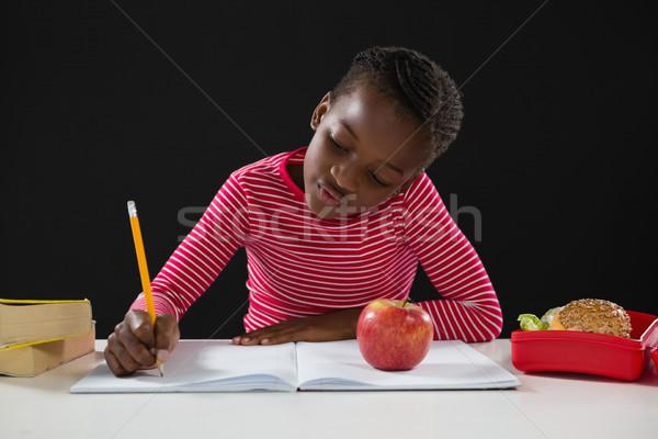 школьница домашнее задание черный внимательный ребенка яблоко Сток-фото © wavebreak_media