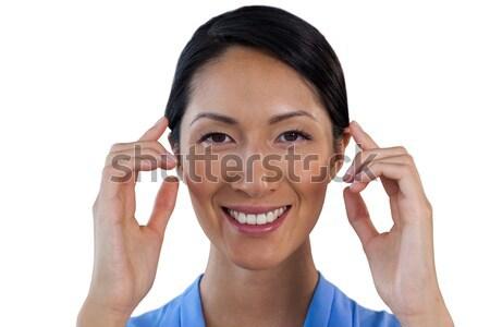 Közelkép portré mosolyog üzletasszony láthatatlan szemüveg Stock fotó © wavebreak_media