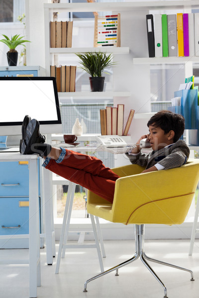 Businessman talking on telephone while sitting with feet up  Stock photo © wavebreak_media