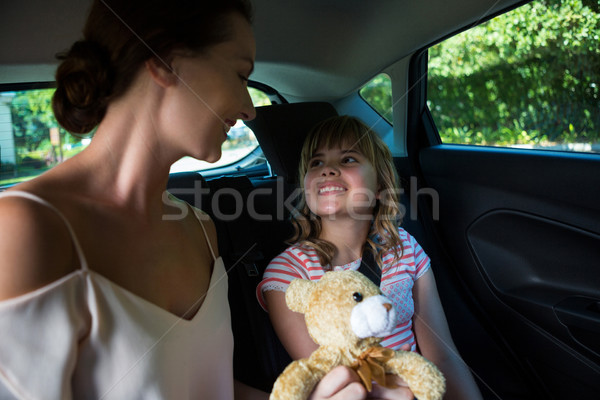 Mother and daughter sitting in the back seat of car Stock photo © wavebreak_media
