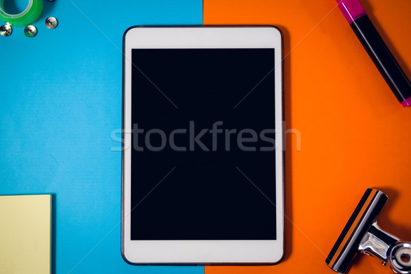 Directly above shot of digital tablet on papers with office supply at wooden table Stock photo © wavebreak_media