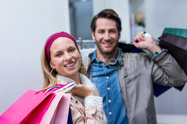 Smiling couple with shopping bags  Stock photo © wavebreak_media