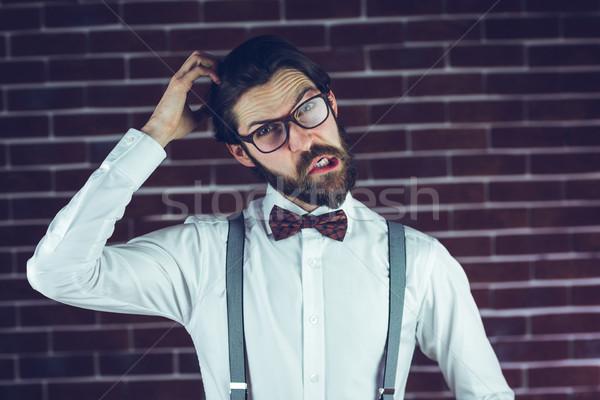 Portrait of man scratching head Stock photo © wavebreak_media