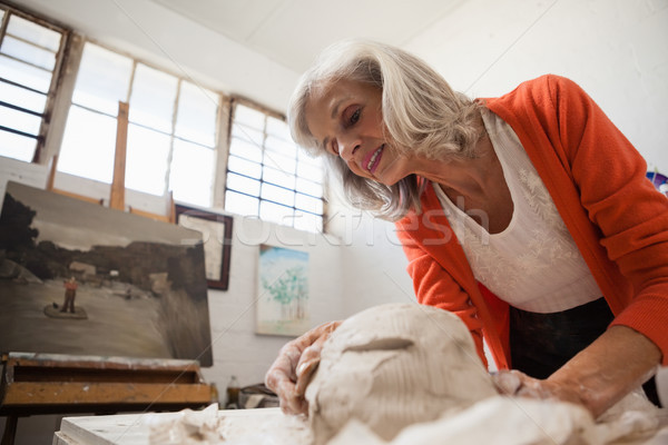 Attentive senior woman shaping a molded clay Stock photo © wavebreak_media