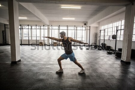 Giovani bodybuilder posa fotocamera crossfit palestra Foto d'archivio © wavebreak_media