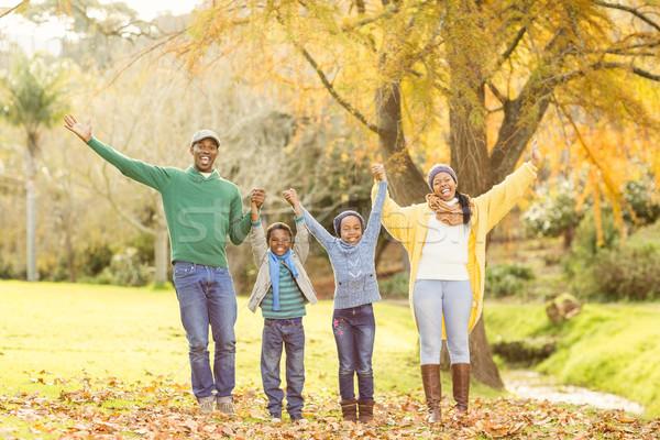 Portré fiatal mosolyog család karok a magasban lány Stock fotó © wavebreak_media