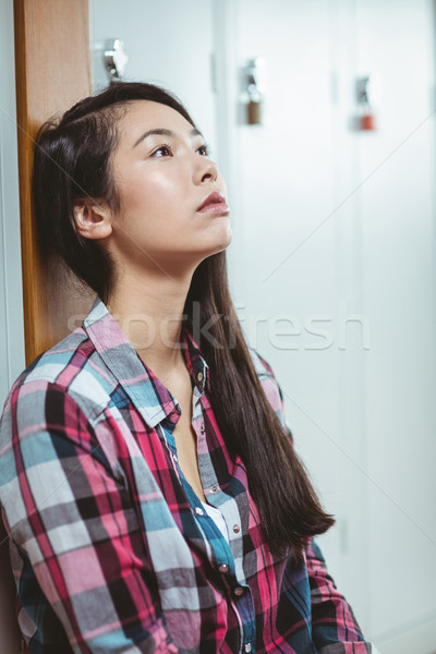 Troubled student sitting and looking up Stock photo © wavebreak_media