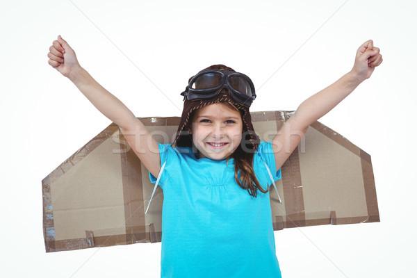 Smiling girl pretending to be pilot Stock photo © wavebreak_media
