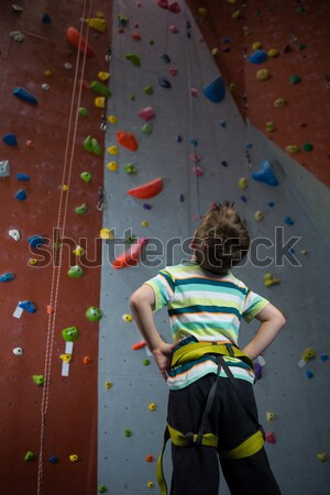Male athlete with hands on hip standing by climbing wall Stock photo © wavebreak_media