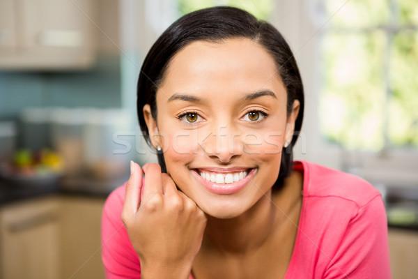 Portrait of smiling brunette in kitchen Stock photo © wavebreak_media