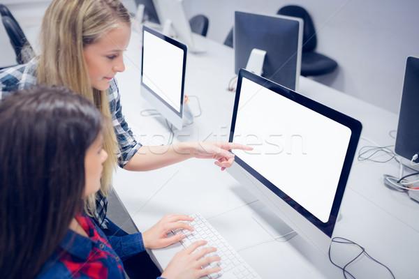 Students working on computer  Stock photo © wavebreak_media