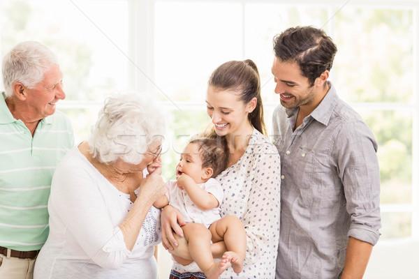 Boldog nagycsalád mosolyog otthon család lány Stock fotó © wavebreak_media