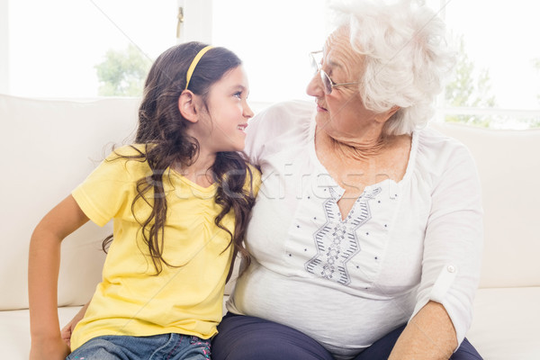 Grandmother and granddaughter looking at each other Stock photo © wavebreak_media
