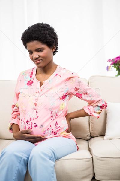 Terhes nő hátfájás kanapé nő otthon egészség Stock fotó © wavebreak_media