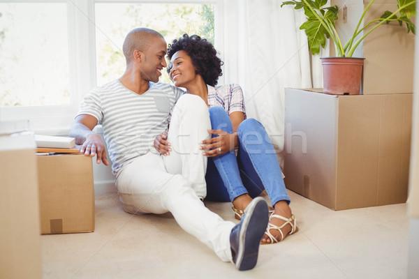 Heureux couple séance étage salon femme Photo stock © wavebreak_media