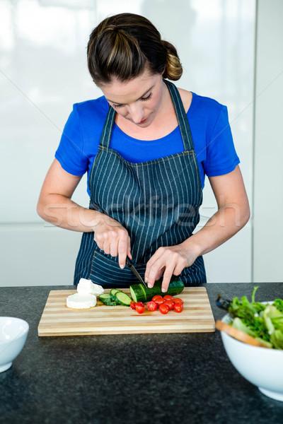 woman preparing sliced vegetables for dinner Stock photo © wavebreak_media