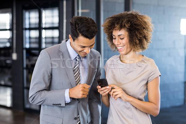 Işadamı konuşma genç kadın cep telefonu ofis Stok fotoğraf © wavebreak_media