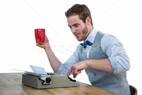 Handsome man using old fashioned typewriter Stock photo © wavebreak_media