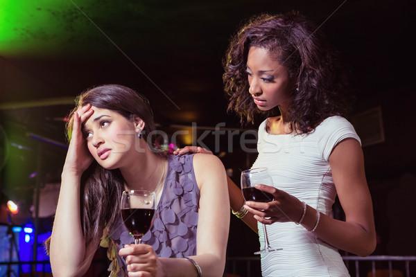 Woman having drinks and comforting her depressed friend Stock photo © wavebreak_media