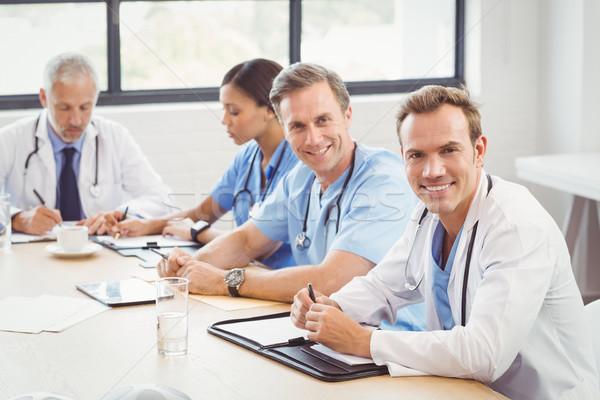 Portret lekarzy uśmiechnięty sala konferencyjna koledzy piśmie Zdjęcia stock © wavebreak_media