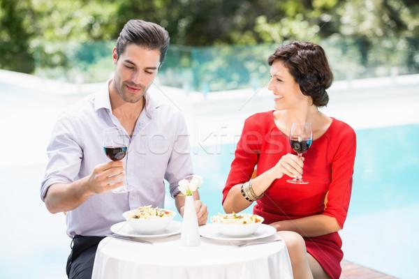 Para wino czerwone okulary posiedzenia żywności Zdjęcia stock © wavebreak_media