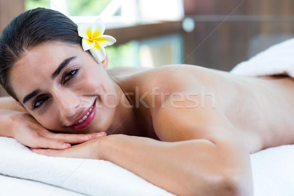 Donna rilassante massaggio tavola spa fiore Foto d'archivio © wavebreak_media