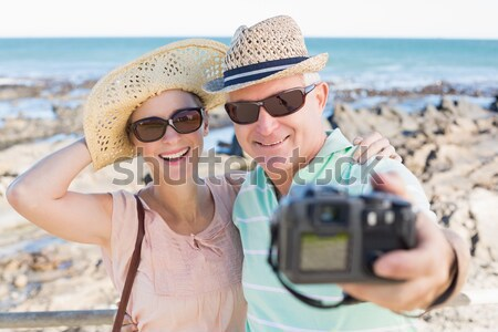 Portrait of couple posing at the beach  Stock photo © wavebreak_media