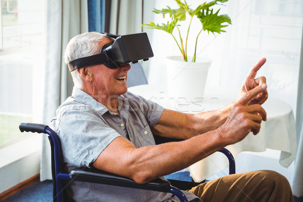 Senior man in a wheelchair using a virtual reality device Stock photo © wavebreak_media