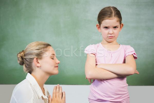 Female teacher apologizing girl in the classroom Stock photo © wavebreak_media