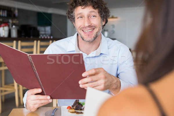 Adam menü kart gülen restoran Stok fotoğraf © wavebreak_media