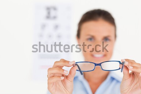 Female optometrist holding spectacles Stock photo © wavebreak_media