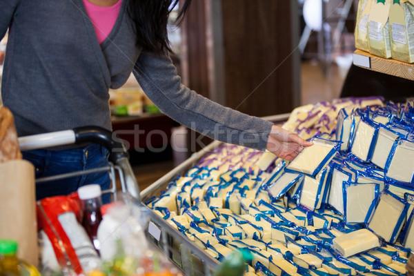 Nő kiválaszt tejtermékek élelmiszer részleg középső rész Stock fotó © wavebreak_media