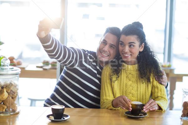 Young couple taking selfie in cafeteria Stock photo © wavebreak_media