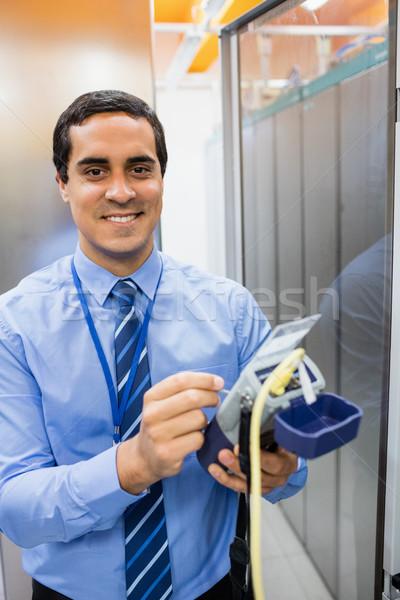Portrait of technician using digital cable analyzer Stock photo © wavebreak_media