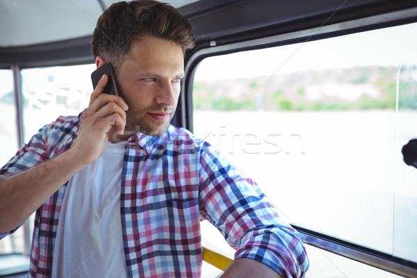 Yakışıklı adam konuşma cep telefonu otobüs sevmek adam Stok fotoğraf © wavebreak_media