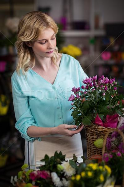 Female florist arranging flowers in basket Stock photo © wavebreak_media