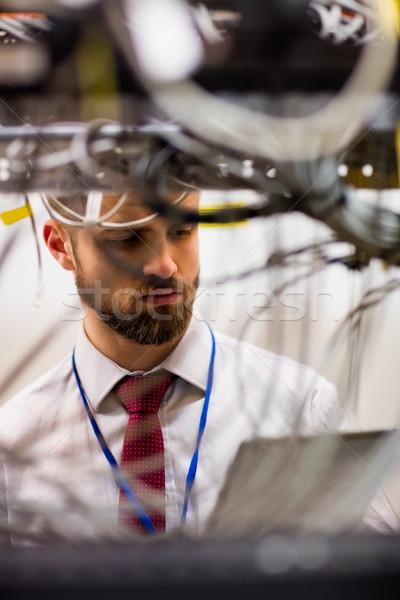 Technician using digital tablet while analyzing server Stock photo © wavebreak_media