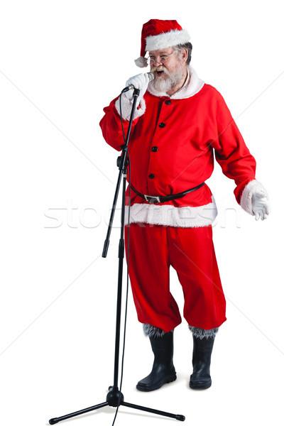 Święty mikołaj śpiewu christmas człowiek szczęśliwy zimą Zdjęcia stock © wavebreak_media