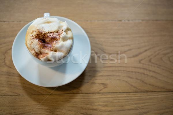 Coffee cup with creamy froth on table in cafeteria Stock photo © wavebreak_media
