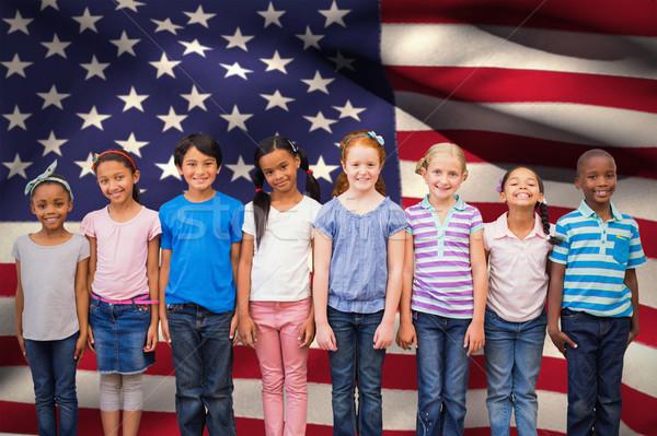 Composite image of cute pupils smiling at camera in classroom Stock photo © wavebreak_media