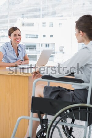 Businessman in a wheelchair on phone during a meeting Stock photo © wavebreak_media