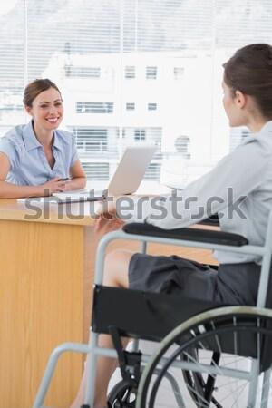 Empresario silla de ruedas teléfono reunión colegas negocios Foto stock © wavebreak_media