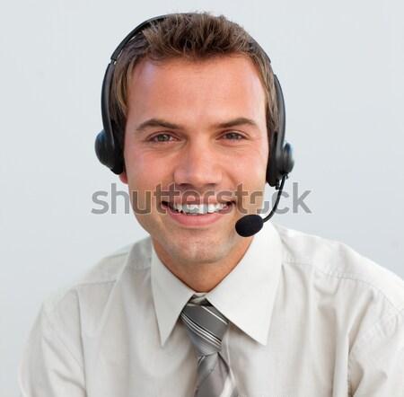 Empresário fone branco negócio sorrir telefone Foto stock © wavebreak_media