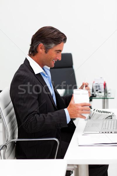 üzletember eszik kínai étel evőpálcika iroda laptop Stock fotó © wavebreak_media