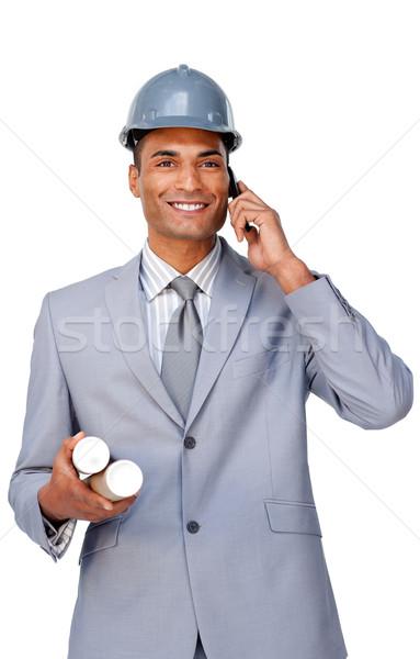Mosolyog vonzó építész visel munkavédelmi sisak telefon Stock fotó © wavebreak_media