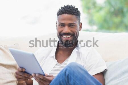 Afro-american businessman drinking a coffee Stock photo © wavebreak_media